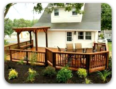 East Moline deck stained and sealed by That British Painter and a custom Pergola added to enhance the space